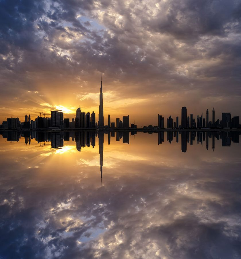 Dubai buildings near water sunset