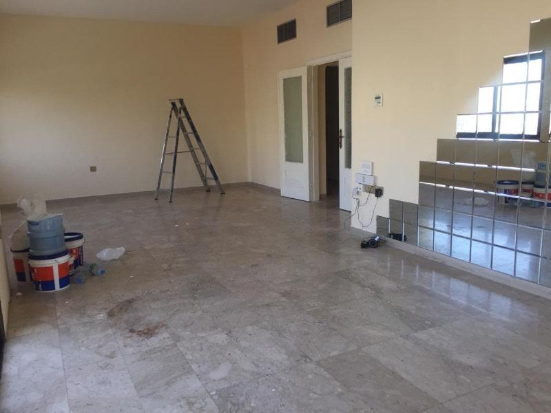 empty living room mirror tiles