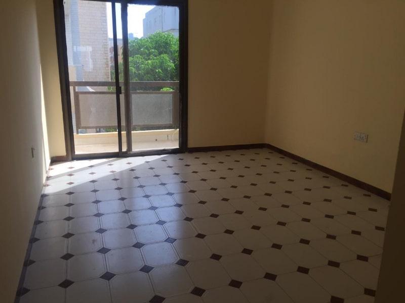 empty room with door to balcony