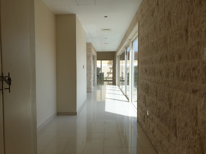 hallway with ceiling height windows