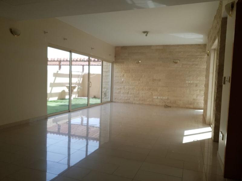 hallway room with patio doors