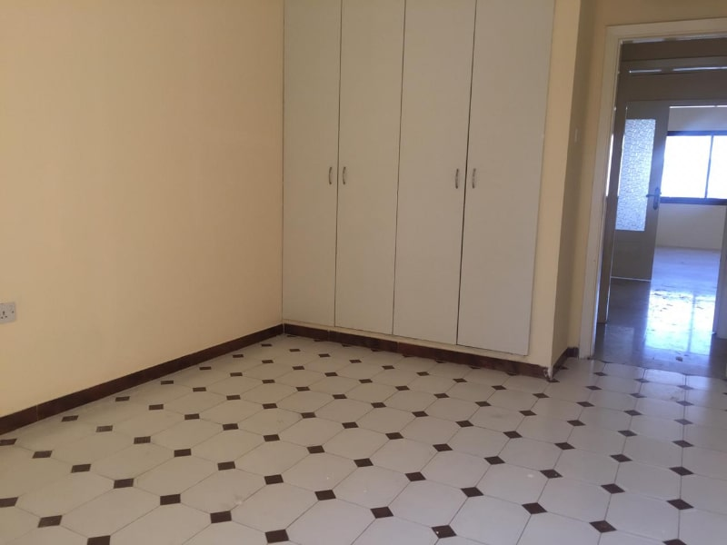 tiled floor and wardrobes